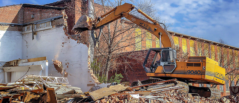 CASE Excavator used by Charlotte Demolition Contractor W.C. Black and Sons to demolish an old commercial building in the NoDa area.